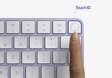 finger-on-touch-id-sensor-in-apple-2021-magic-keyboard-imac